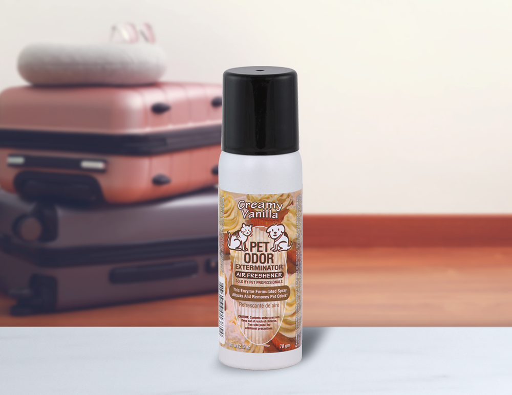 Creamy Vanilla 2.5oz Mini Spray with luggage in background