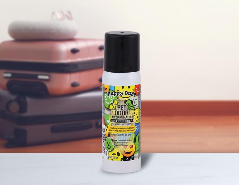 Happy Days 2.5oz Mini Spray with luggage in background
