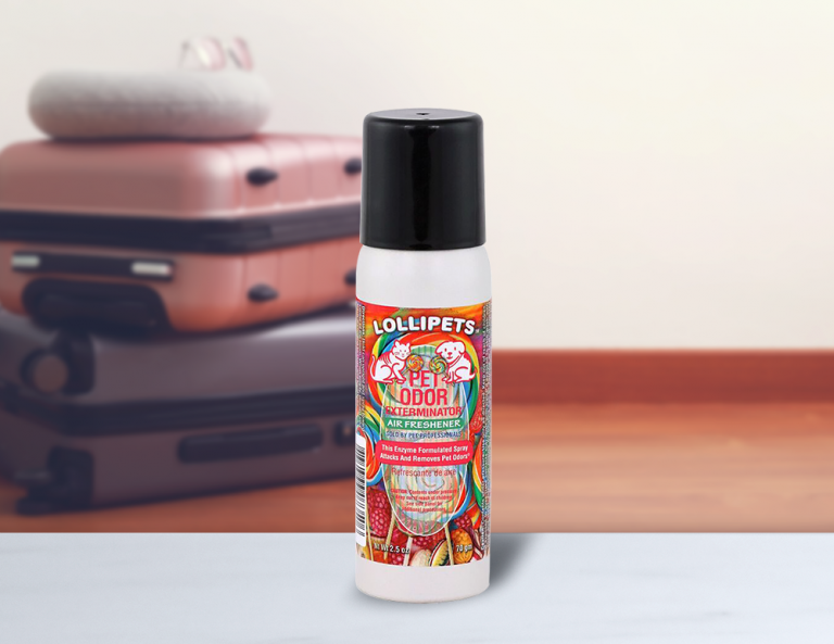 Lollipets 2.5oz Mini Spray with luggage in background