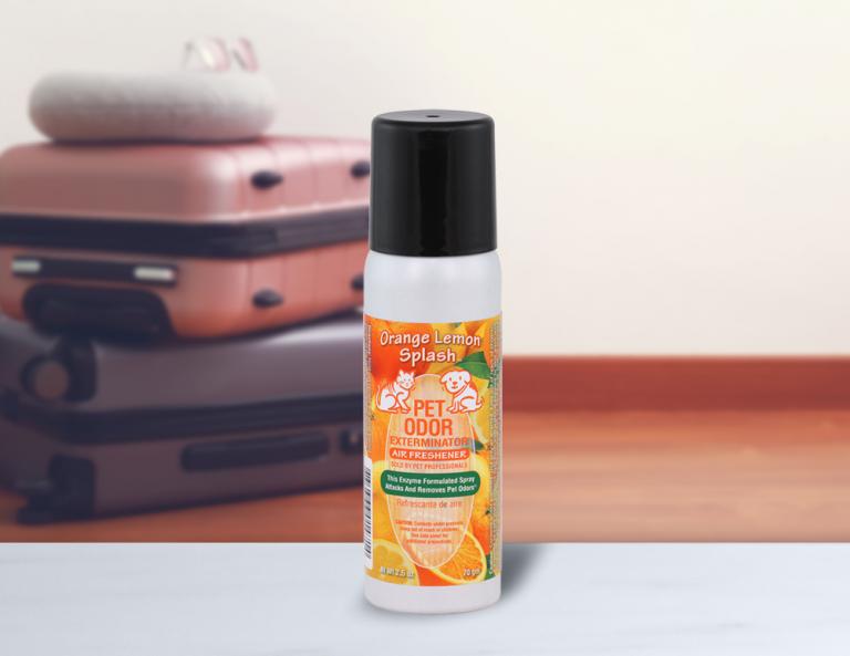Orange Lemon Splash 2.5oz Mini Spray with luggage in background